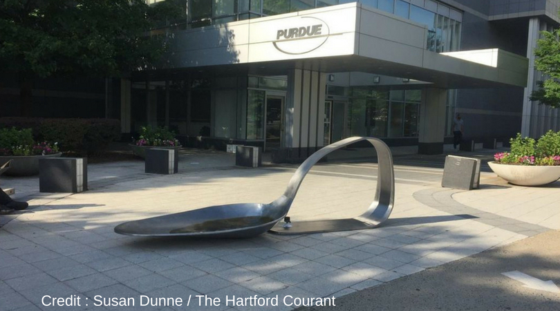 Artist creates giant spoon and sets it in front of Perdue Pharma headquarters, The Recover